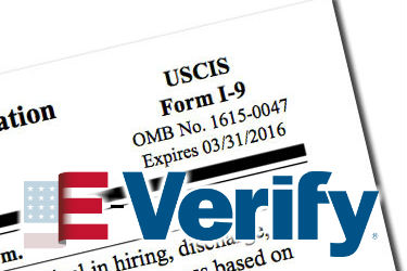 E-Verify logo over Form I-9